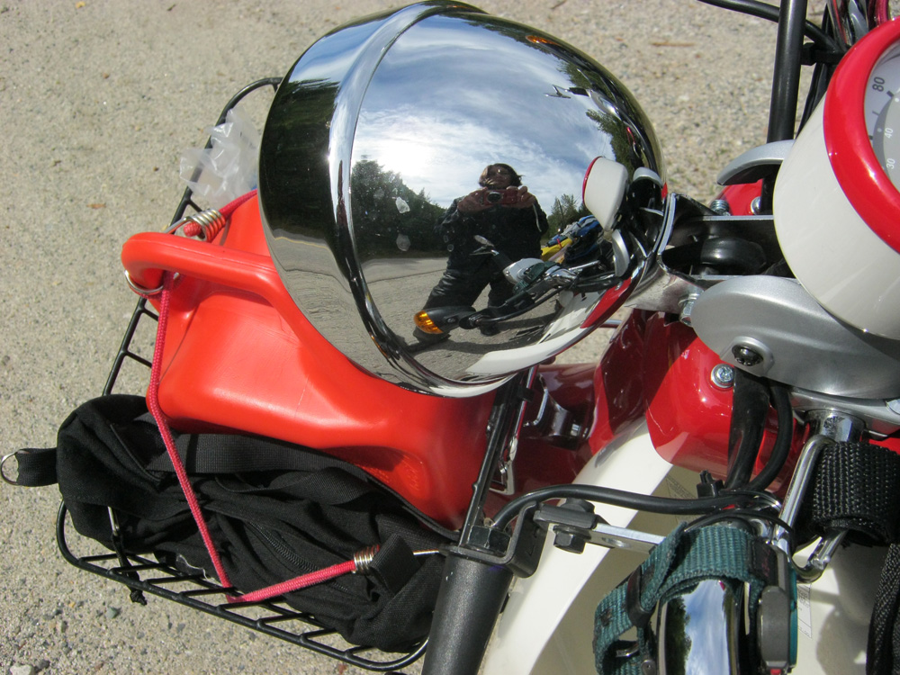 Chrome deadlight of Symba Honda Cub motorbike
