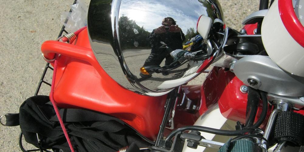 Chrome deadlight of Symba Honda Cub motorbike