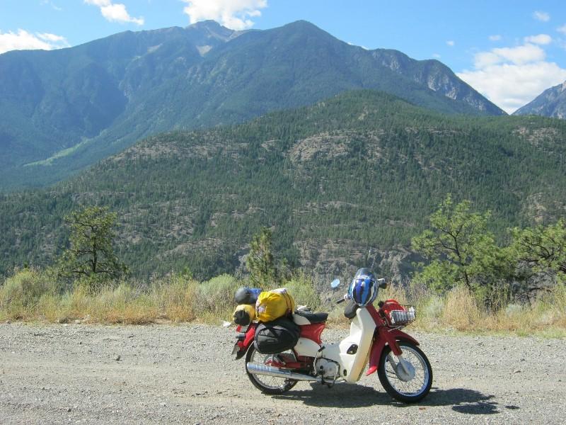 Symba motorbike on roadside near Lilloet, BC