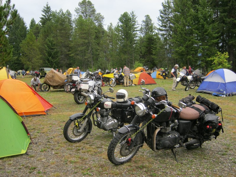 BMW, KTM, and Yamaha dual-sport bikes at Nakusp campground