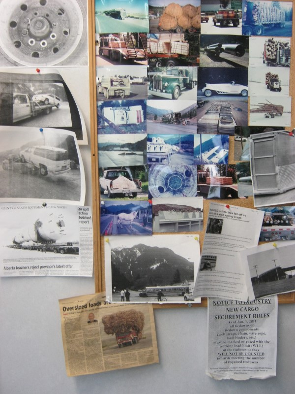 Bulletin board with photos of overloaded trucks