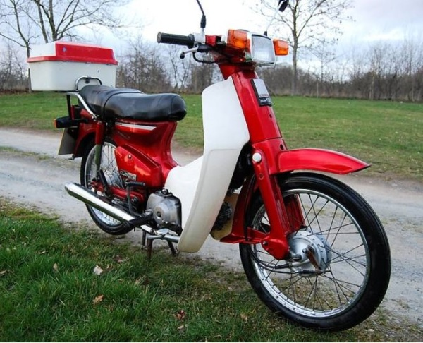 Red and white Honda C90, circa 1988
